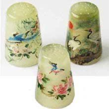 Set of 3. Oriental nature scenes with exotic birds are hand-painted on solid jade thimbles