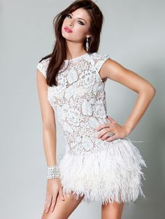 Dress For Top Heavy Body Shape:    Check out: Dress sp12075    Homecoming Dresses  . This dress is in white and looks great on a heavier top while bringing all the attention to the bottom half. With it's lace top to bring the eye down and ostrich feather skirt to make a balanced, hourglass shape.