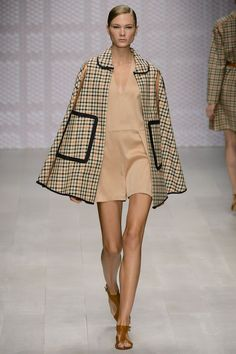 Daks s/s 13 - Daks are consistently successful in their outerwear each season. Love this cape with its wonderfully classic British Heritage feel. This look is one of my faves from this mornings show. Do you like this too? #LFW