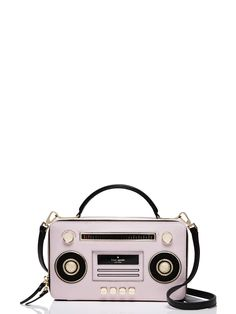 turn it up! this leather bag is designed to look like an old-school boom box, complete with golden play, rewind and fast forward buttons. but it's not just a novelty item: the roomy zip-around main compartment and optional, adjustable shoulder strap make this purse as practical as it is droll.
