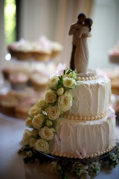 A close-up of our sweetheart cake. We bought the Willow Tree cake topper on Amazon. So sweet!