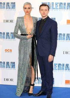 Cara Delevingne holds her dress in place alongside co-star Dane DeHaan