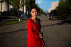 Before entering North Korea, I was thinking I would be lucky if I make a portrait there. Came back with a photo series, surprised that women were really open to be photographed.   I met her on one of the largest boulevards of Pyongyang, the capital of the country, in September 2015.