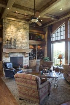 The most stunning feature of this living room is a tie between the giant windows and the hand-laid stone fireplace. (Home Design & Decor by B.L. Rieke & Associates, Inc.) Visit us at blrieke.com