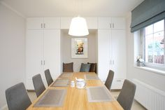 dining room with grey chairs