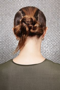 Pin the bun in place with bobby pins, but leave out the tail end of the braid. Work some gel through it and style it so it falls sharply to one side for a graphic finish. #refinery29 http://www.refinery29.com/how-to-style-wet-hair#slide-17