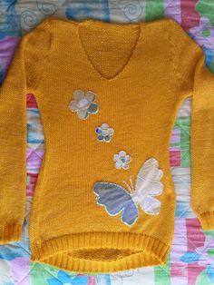Buso o saco en lana con apliquez  en tela.