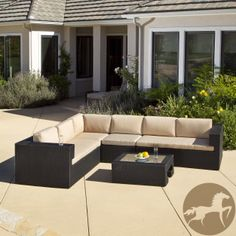 Add stylish comfort to your outdoor decor with this five-piece wicker sofa and table set. This set features a durable construction and Sunbrella cushions that are made for years of outdoor use.