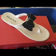 Sandals Tan and black jelly sandals never worn Bootsi tootsi Shoes Sandals
