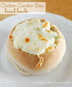 Chicken Cordon Bleu Bread Bowls: Move over soup, there's a new way to fill bread bowls! #recipe #chicken -from creationsbykara.com