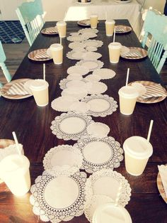 using paper doilies as a table runner - genius. Perfect for a little girls party but would be great for a bridal shower or even a simple tea party