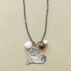 """HEALTHY HEART NECKLACE -- In this sterling silver heart pendant necklace, a hammered sterling heart hangs fluidly from an oxidized sterling silver chain accompanied by two white pearls and a sparkling garnet, said to symbolize good health. Handcrafted in USA. Exclusive. 18""""L."""