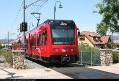 """Parts of the San Diego Trolley get very Interurban-ish outside of downtown, running on shared railroad tracks with freight or as here, a single track into the """"Trolley Square"""" development."""