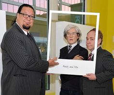 On Thursday, April 24, comedic magicians Penn & Teller posed with a Madame Tussauds wax figure of Andy Warhol during the grand opening of the Polaroid Museum at The LINQ (Photo credit: David Becker/Getty Images).