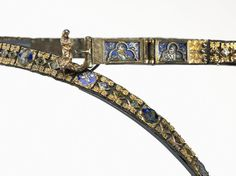 Belt for a Lady's Dress, c. 1375-1400 Italy, Siena?, 14th century basse-taille enamel and gilding on silver, silver thread, gilt-silver buckle, cast and chased, Overall - h:236.50 w:2.90 d:0.60 cm (h:93 1/16 w:1 1/8 d:3/16 inches). Gift of the John Huntington Art and Polytechnic Trust 1930.742 Location: Gallery 110 More images at home site.