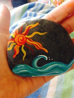 Sea rock collected along the beaches of San Diego, hand painted with acrylic paint and sealed with varnish. One of a kind! Would be great on a patio,