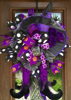 purple and black halloween witch wreath with legs