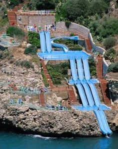 ITALY – Water slide into the Tyrrhenian Sea at the Città del Mare Hotel Village, metropolitan area of Palermo, island of Sicily. It's located on the Città del Mare road off of Strade Statali (state road) outside of the town of Terrasini. Oh The Places You'll Go, Places To Travel, Places To Visit, Travel Destinations, Dream Vacations, Vacation Spots, Vacation Ideas, Italy Vacation, Sicily Hotels