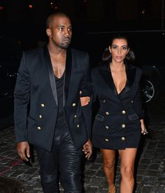 Kanye West and Kim Kardashian in 2014. See 17 more celebrity couples who dress alike.