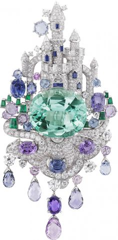 Van Cleef & Arpels Peau d'Âne Château enchanté clip in white gold with diamonds, emeralds, pink and purple sapphires, sapphires and one oval-cut emerald of 39.85 carats