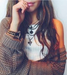 Casual boho outfit with the layered necklaces and bracelets with the huge cardigan to tone the outfit down.