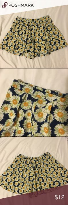 Sunflower Flowy Shorts Super fun and cute sunflower shorts! small non-stiff pleats in the front; elastic waistband in the back; so flowy that the shorts can be mistaken as a skirt Mimi Chica Shorts