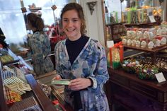 16.21 Miriam Stein shopping for sweets in Vienna - wearing the A Day in a Life Mountain Printed Silk Chiffon Shirt Dress and the Navy Ribbed Turtleneck Dress