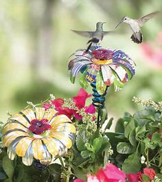 Sugar Shack Hummingbird Flower -- made from recycled glass with recycled aluminum can petals at Duncraft.com