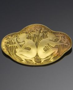 Lalique 1913 'Deux Figurines Dos-a-Dos Brooch: cast & foiled golden-orange glass plaque depicting two crouching maidens among flowers and foliage, stamped Lalique