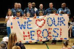 Students present a banner to officers of the Colorado Springs Police Department during a Hero Day celebration Sept. 11 at Odyssey Elementary School in District 49. The students observed Patriot Day with activities honoring selfless service in their community.