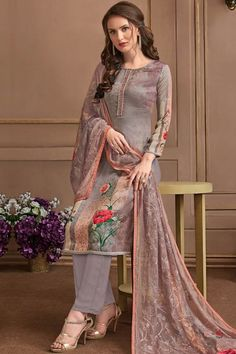 This Warm grey Satin Georgette Trouser Suit which makes it astonishingly charming. Present with Santoon Trouser in Grey Color with Mauve Georgette Dupatta.