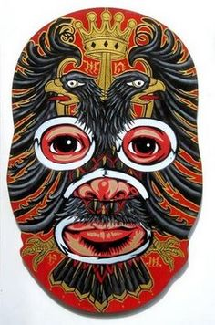 Artist Peat Wollaeger sent wooden luchador masks to artists around the world-who painted on them- and sent them back for Peat to finish with the eyes/nose/mouth.