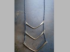 Love this necklace called Cervical Spinal Fusion from Chicago Metalsmith Jules.