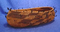 "Baskets, the most developed art of the Central California tribes, can be attributed a tribal affiliation based on an analysis of materials used, weaving techniques, form and style. Although all techniques of coiling and twining were explored, the tightly coiled basket was the most developed.  Here is a high end example of a Pomo ""Boat Basket"", circa 1900 from Central California."
