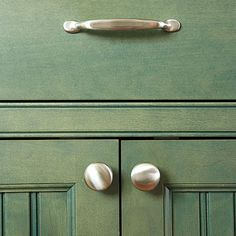 PRO ADVICE: Inset cabinet doors, such as these beadboard panels, can take exposed hinges, a detail that really adds character to a period-style kitchen