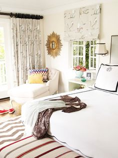 love the gold sun ray mirror and the chaise in this bedroom... and of course the gray chevron striped rug, which I may or may not (it's may) be a little obsessed with right now