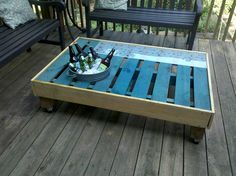 I, Marian Williams, made this here pallet table for $3.63, minus the beer