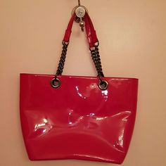 "$$ DROP DKNY new hot pink tote w/gunmetal hardware Need to sell ASAP for another bag!! This tote is so Shiney and the hardware is gorgeous!! It is also big at 11.5"" deep & 17"" across the top. While it is beautiful, it is way bigger than I usually carry so I have never used it. It has been in dust bag in custom purse storage unit since I bought it. Inside has 1 zippered &2 small pockets.  PLEASE look at 3rd pic that shows bottom.....I do not know what the dark marks are but they are not on…"