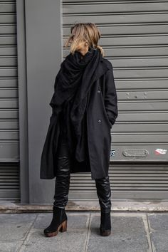 justthedesign:  Camille Callen's all black outfit consists of a chic rain mac, leather trousers, and heeled ankle boots.Jacket/Blouse/Trousers: Topshop, Scarf: Mango.