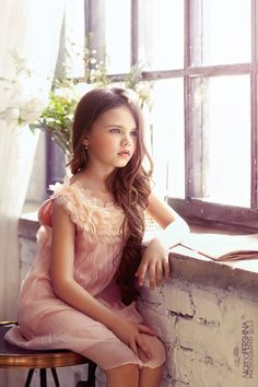 What an exquisitely perfect little girl she is, and such a sweet dress