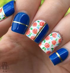 The Multicolored Floral Nail Art Design.The multicolored floral nails with the punch of bold blue and gold definitely makes a good nail art choice.