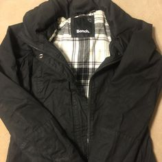 Bench brand jacket Only worn once. Bench brand navy blue jacket/coat. It is heavy and is lined with a cute plaid print. It have the roll up hoodie/ detachable hoodie. It zips at the neck. Very nice jacket. All my items come from a smoke free home. Bench Jackets & Coats Utility Jackets