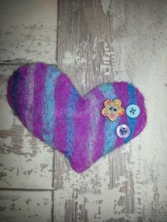 Heart shaped needle felted handmade brooch.