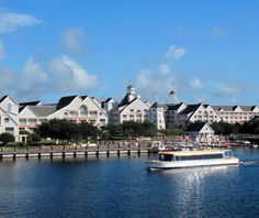 """Disney's Yacht Club Resort (Orlando, FL). """"You'd be hard-pressed to find an Orlando property that's more devoted to the ultimate lakeside experience than Disney's Yacht Club Resort. The hotel's nautical-crisp design is reminiscent of Nantucket and Martha's Vineyard—except it's located on Florida's Crescent Lake. Explore in one of the resort's pontoon boats, or let the kids loose on the waterslide."""""""