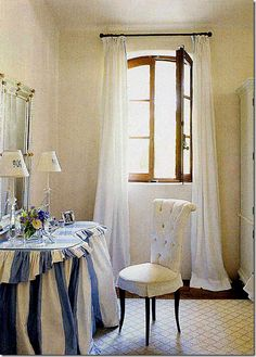 Room with lovely skirted vanity by Renea Abbott, featured in Cote De Texas Blog.