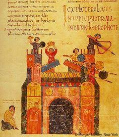 Beato de San Miguel de la Escalada o Beato Thompson (año 960 aprox.). El armamento es muy similar. Como novedad la presencia de un lanzador de piedras que se protege con una adarga. Otras adargas cuelgan de las almenas a modo de decoración.