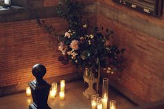 Dusty blush and cream arrangements under towering Bradford Pear for the wedding of Liz & Bert at the Highline Hotel.