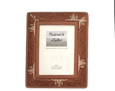 $48  A 5x7 leather picture frame embossed with a longhorn pattern. We hand paint the longhorns giving it a lovely effect! We use high quality materials, have a Plexiglas in it and an easel back so it's all ready for you. Need an unique gift?