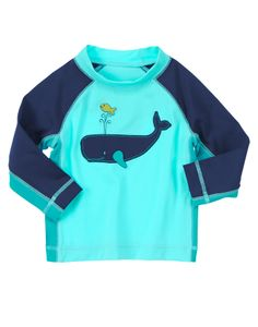 Your little swim star is covered in the sun in our long sleeve whale rash guard. Happy whale and fish design add a splash of fun to our comfy swim top.