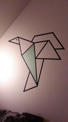 I have made this beautiful Origami inspired Bird, it's made of Washi masking tape and gives my living/bed room a wonderful modern touch. Easy to make yourself and easy to remove without making marks on the wall.